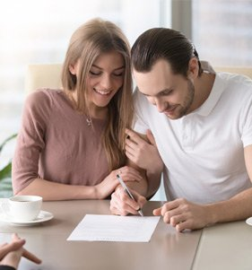 couple signing a document